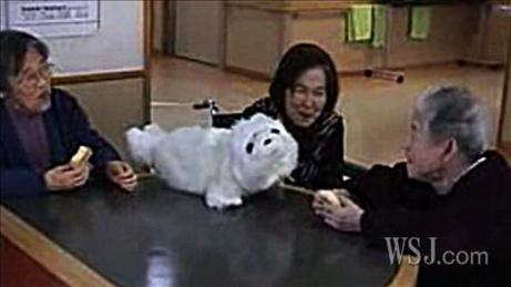 Here, elderly patients appear to be enjoying the company of Paro, a robotic seal. Image: http://online.wsj.com/article/SB10001424052748704463504575301051844937276.html