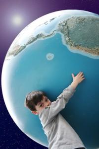 boy-hugging-globe
